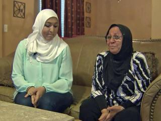 Nazeeha Asad, right, saw her family home on television as she watched reports of fighting in Gaza.