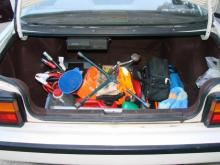 Walt Brinker keeps his trunk packed with tools useful for helping stranded motorists