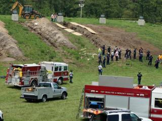 Emergency workers converge at the scene of a trench collapse that killed a construction worker Thursday (July 24, 2014) on Fort Bragg.
