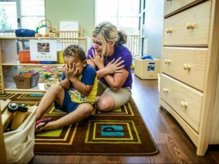 Elizabeth Evans acts out a song with 2-year-old Isaac Craig at a center run by Educare, a program described by one expert as 'Head Start on steroids.' (Photo by James Robinson/The Fayetteville Observer)