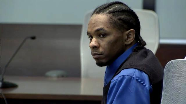 Laurence Lovette, on trial for first-degree murder in the 2008 shooting death of Abhijit Mahato, listens to hs defense attorney, Karen Bethea-Shields, present closing arguments to the jury on July 28, 2014.