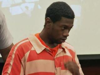 Kevin Bernard Britt enters a Wake County courtroom Aug. 4, 2014, to face charges in the July 19, 2014, shooting deaths of Arthur Brown, 78, David McKoy, 66.