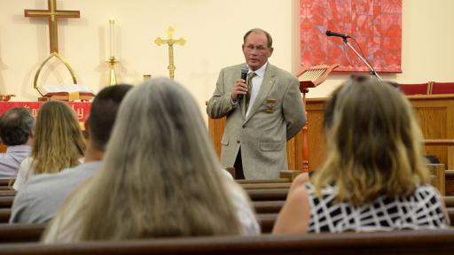 Harnett County Sheriff Larry Rollins spoke to nearly 130 residents at Spring Hill United Methodist Church in Lillington on Monday after a rash of violent crime over the weekend left one person dead, three people shot and another in the hospital after a police chase. (Adam Owens/WRAL)