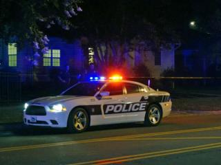 Durham police investigate a reported home invasion on East Club Boulevard on Friday, Aug. 8, 2014.
