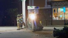 IMAGES: Car wrecks on Raleigh's Glenwood Avenue, nearly clips gas pump
