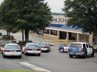 Raleigh police tape off part of a Food Lion parking lot on New Bern Avenue on Aug. 9, 2014, after a shooting.