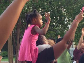 The crowd raised their hands during a National Moment of Silence at 7:20 p.m.