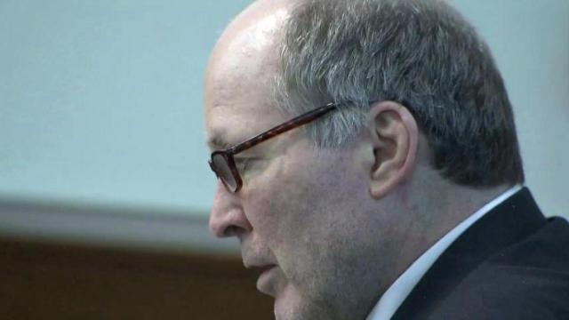 Walter Ray Reinhardt listens to testimony on Aug. 15, 2014, during the first day of his securities fraud trial in Durham.