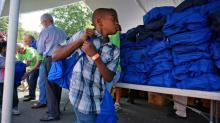 IMAGES: Free backpacks, food: Durham nonprofit hosts back-to-school party