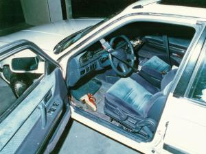 A crime scene photo of the interior of Beth-Ellen Vinson's 1990 Mazda 626 on Aug. 16, 1994. The car was still running, and the radio was on when it was discovered. A shoe was found on the floor of the driver's side.