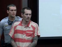 Daniel Scott Remington makes his first court appearance Aug. 25, 2014, three days after Cary police say he shot Wendy Jean Johnson, 53, outside an apartment complex.