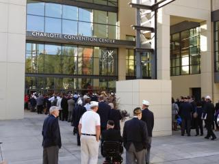Veterans line up to hear President Barack Obama speak at the Charlotte Convention Center on Tuesday, Aug. 26, 2014.