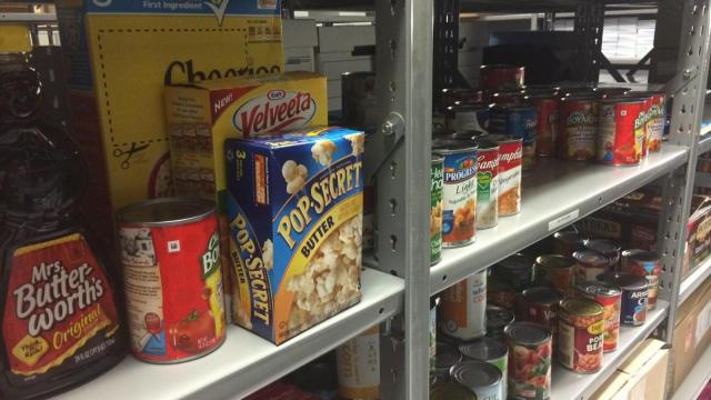 Nonperishables are stacked on shelves at Rolesville High School for its Backpack Buddies program. Hungry teens can get a backpack full of food with no questions asked.