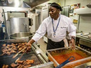 Gordon Simpson left prison seven years ago and eventually landed a job as chef at first Assembly Christian Schoo, were he cooks meals for about 500 children a day. On the side, he runs his own catering business.