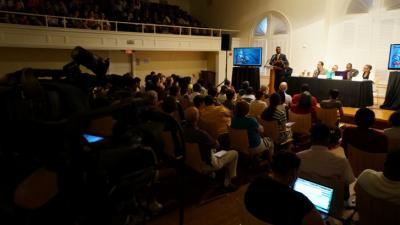 A diverse crowd of more than 300 students, faculty and community members packed the Nelson Music Room on the school's East Campus for what organizers described as an academic event - not a rally or call to action - about the police shooting death of an unarmed 18-year-old in Ferguson, Mo. (Greg Clark/WRAL)
