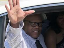 Leon Brown drives away from prison a free man on Sept. 3, 2014, after his first-degree murder conviction for the 1983 death of Sabrina Buie was overturned by a judge in Robeson County.