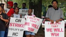 IMAGES: Fast food workers rally for higher pay, union rights