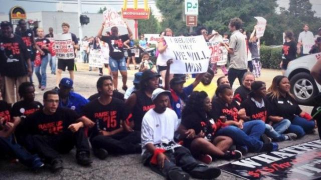 Nearly 30 people were arrested in Durham on Thursday while protesting for fast-food companies to raise worker pay. (Submitted by Zania Alsous)