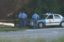 Raleigh police investigate a report of a violent crime on Crabtree Creek trail on the Capital Area Greenway on Sept. 21, 2014.