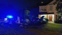 IMAGES: Two injured when car crashes in front yard of Raleigh home