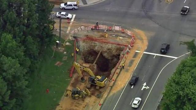 The 25-foot sinkhole originally opened up in early September 2014 when a pipe ruptured.