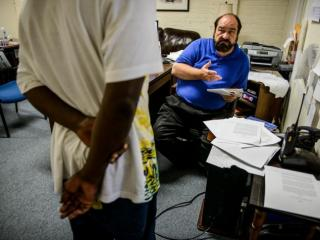 The Rev. Jim Summey, executive director of High Point Community Against Violence, talks with a client at the center on Sept. 10.