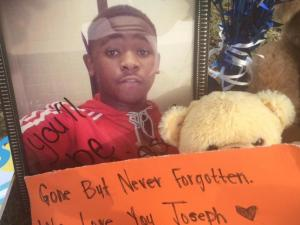 Friends and family of Joseph Braxton III created a memorial near where he was killed Saturday night. (Candace Sweat/WRAL)