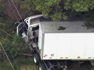 A tractor-trailer and car were involved in a wreck Wednesday afternoon on Red Mill Road in Durham County.