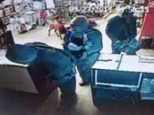 An image from a security camera shows thieves stealing 71 handguns and two rifles from Calypso Wholesale, at 108 4th St. in the Duplin County town of Calypso, on Sept. 27, 2014.