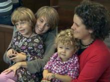 Gay couples shift from marriage battle to adoption