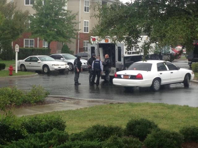 Law enforcement officers respond to Magnolia Pointe Apartments, where a man who man be armed was refusing to come out of a unit.<br/>Reporter: Arielle Clay