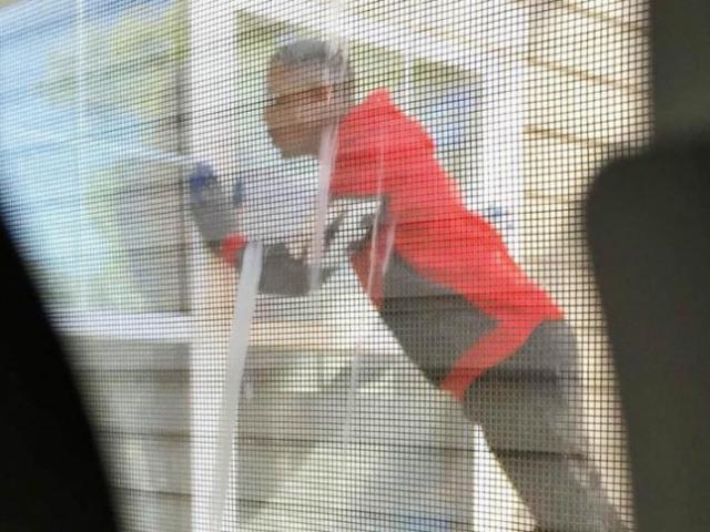 Raleigh police are trying to identify a man photographed trying to get inside a home on Strome Avenue in northwest Raleigh on Oct. 6, 2014.