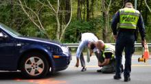 IMAGES: Crossing guard hit by car in Garner