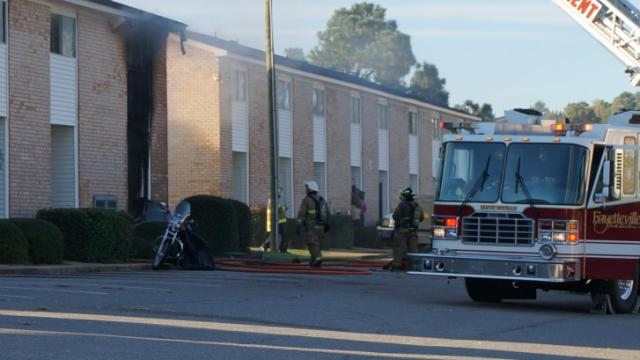 The Cambridge Arms apartments in Fayetteville caught fire Monday afternoon. It was not immediately clear what caused the blaze.