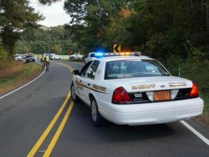 Durham County deputies block access to Archery Range Road near Bahama, where a small plane crashed on Oct. 21, 2014.