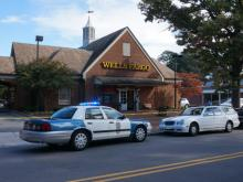 Police tape surrounds a Wells Fargo bank at 2016 Fairview Road in Raleigh on Oct. 24, 2014.
