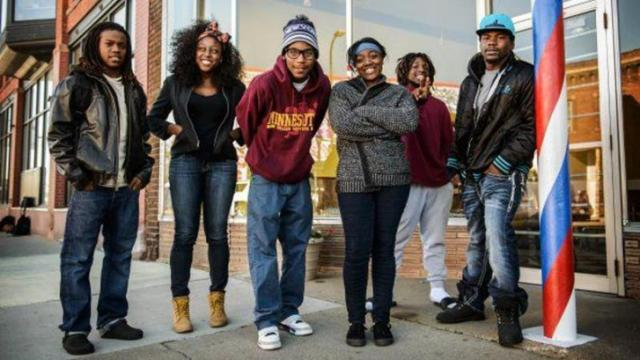 The Build program in Minneapolis aims to stem violence by reaching out to neighborhood youths. From left are Tyrone Hite, Colleen Enwesi, Isaiah Hudson, Tacarra Durrah, Javonta Kelly and Soldon Armstrong, who all work to show young people that they can lead healthy lives without joining a gang. (Photo by James Robinson/Fayetteville Observer)