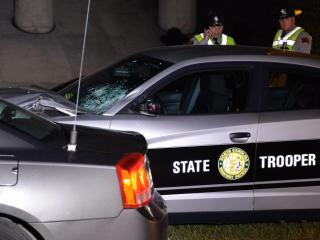 A pedestrian was struck and killed Monday night after running into the path of a N.C. State Highway Patrol trooper's vehicle on the All-American Freeway at Cliffdale Road, police said. (Adam Owens/WRAL)
