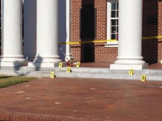 Authorities investigate following an Oct. 28, 2014, shooting outside the Nash County Courthouse.