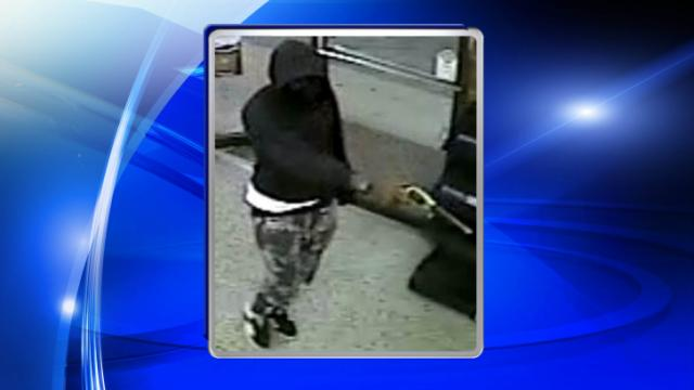 An image from a store security camera shows a man who Fayetteville police said robbed four stores between Oct. 24 and Oct. 29, 2014.