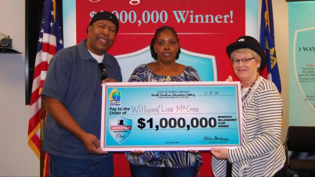 William and Lisa McCrea collect their lottery winnings.