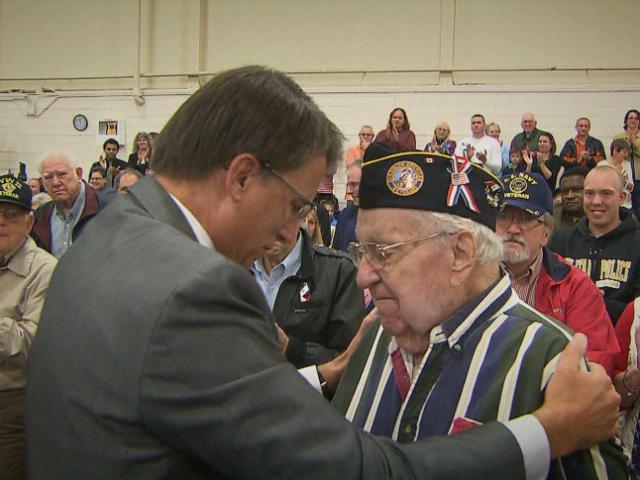 Gov. Pat McCrory embraces 96-year-old World War II Army veteran Richard Plott during a Veterans Day celebration in Butner on Nov. 11, 2014.<br/>Photographer: Richard Adkins