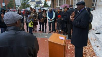 A few dozen people rallied against violence in front of the Wilson County Courthouse on Sunday, days after a fourth arrest was made in Wilson's latest homicide.