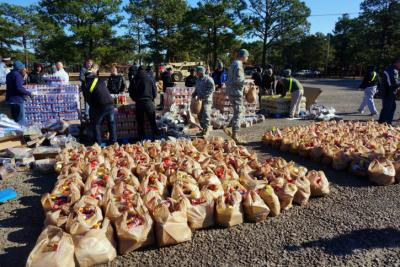 "In the ""Thanks for Giving"" program, Operation Homefront provided 25 pounds of goods to 400 Fort Bragg soldiers and their families on Nov. 20, 2014. The families also received 10 pounds of items from Feed the Children and a frozen turkey."