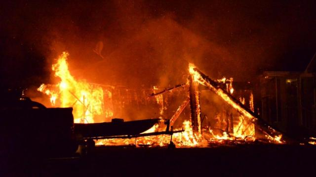 Firefighters responded to a blaze Thursday night in the Virginia Downs Subdivision near Clayton. Photos by John Payne.