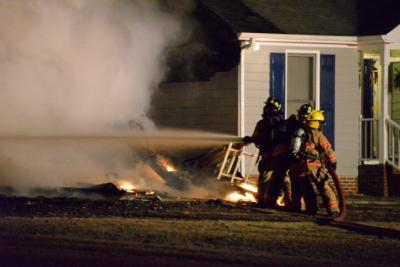 Firefighters responded to a blaze Thursday night in the Virginia Downs Subdivision near Clayton. Photo by John Payne.