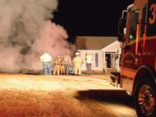 Residents escaped a fire that burned the garage of their home Thursday night in the Virginia Downs Subdivision near Clayton, authorities said. Photo by John Payne.
