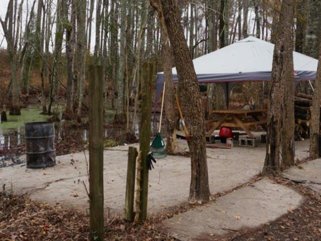 Robeson County authorities are investigating the deaths of three people found Nov. 30 in some woods  known as a party area  behind a home on McLeod Drive in Maxton.<br/>Photographer: Michael Joyner