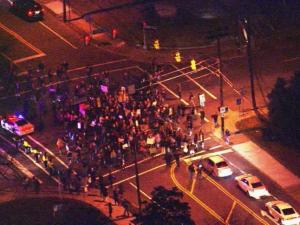 Protesters corwd an intersection in downtown Durham Friday night.
