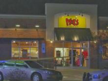 Fayetteville police were searching for an unidentified man early Wednesday after an armed robbery and shooting injured two employees at a Moe's Southwest Grill on North McPherson Church Road.